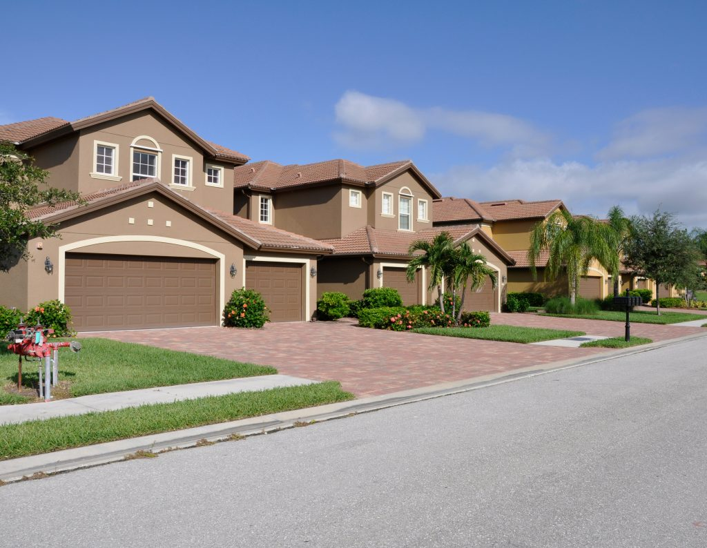Row of typical new modern homes in a neighborhood in Naples Florida